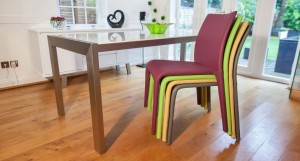 Argenta Coloured Faux Leather Dining Chairs shown stacked