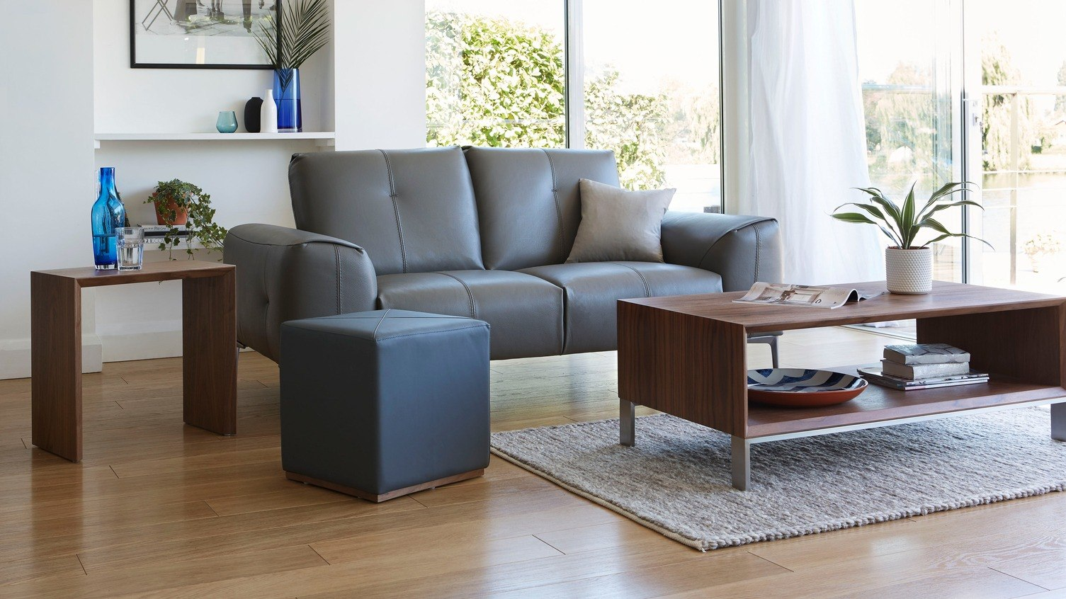 Create a welcoming living room setting by using real leathers and warm walnut finishes.