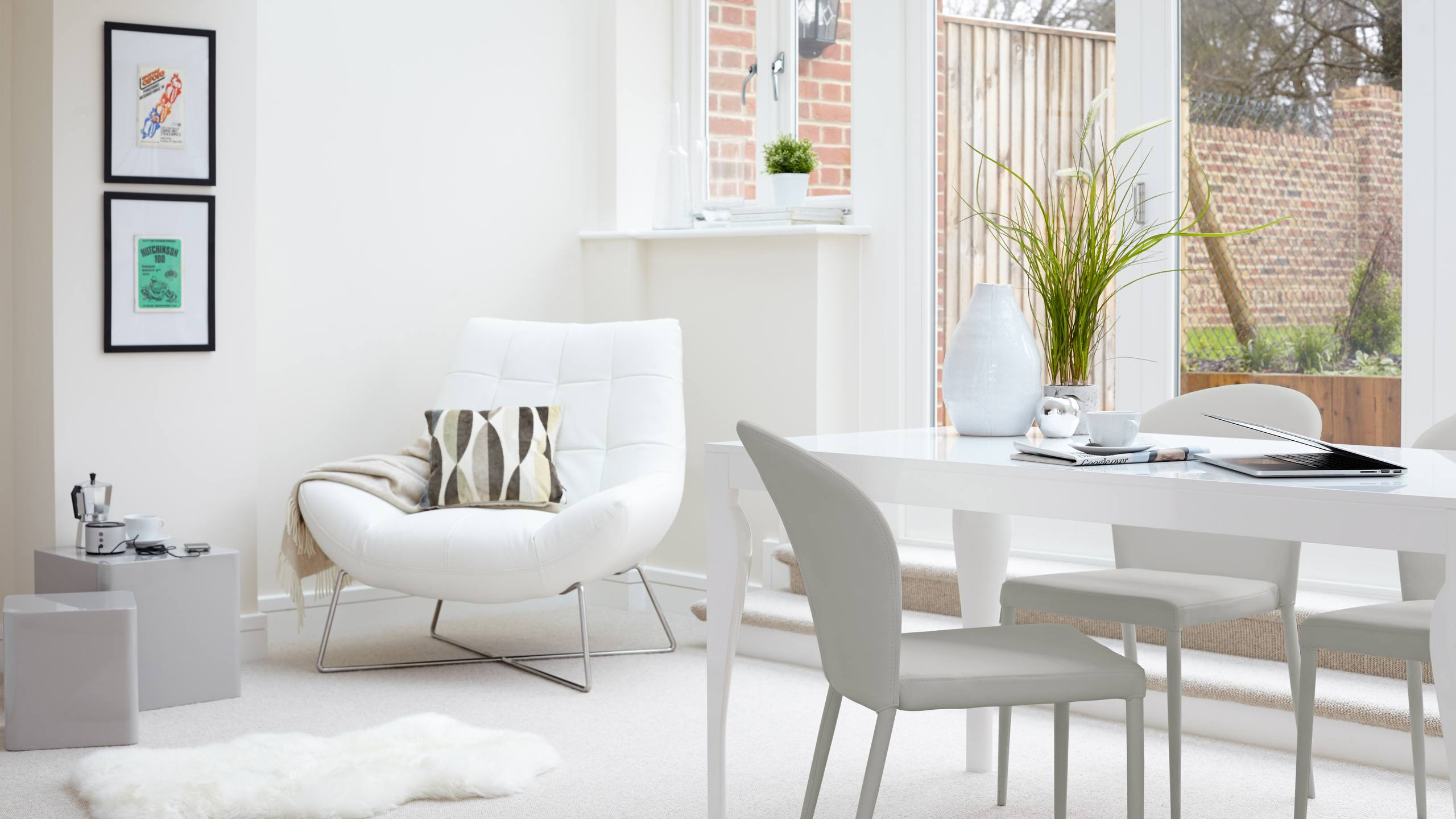 Having an open plan space means you can zone a variety of different areas. For example, here we have a living and dining combo that looks light, modern and still wonderfully spacious. Products: Canio Occasional Chair, Dice Side Tables in grey and Santo Stackable Dining Chairs.