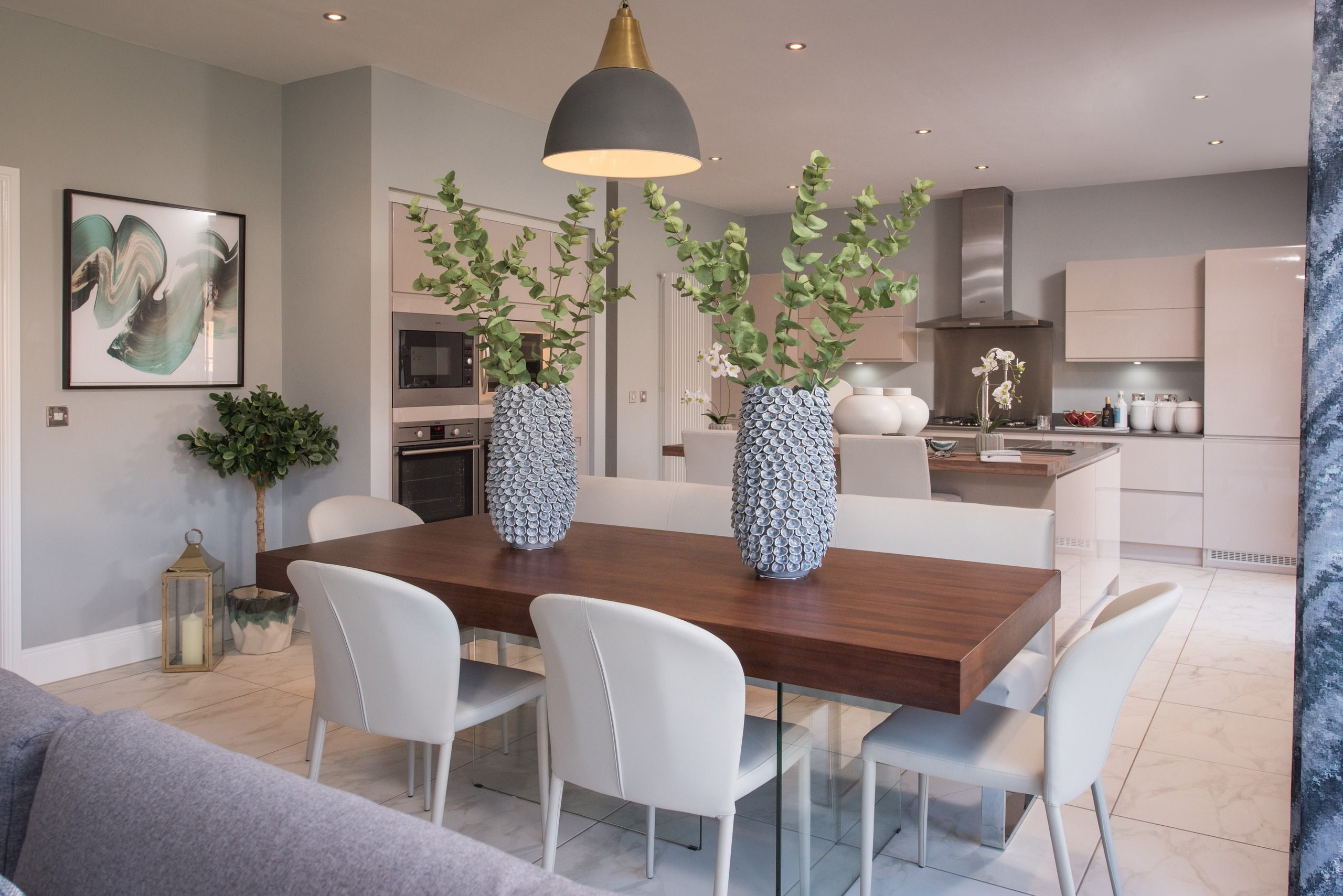 This kitchen/dining/living open plan area by Interhouse Design shows how you can combine different zones to create a connected and cohesive look.