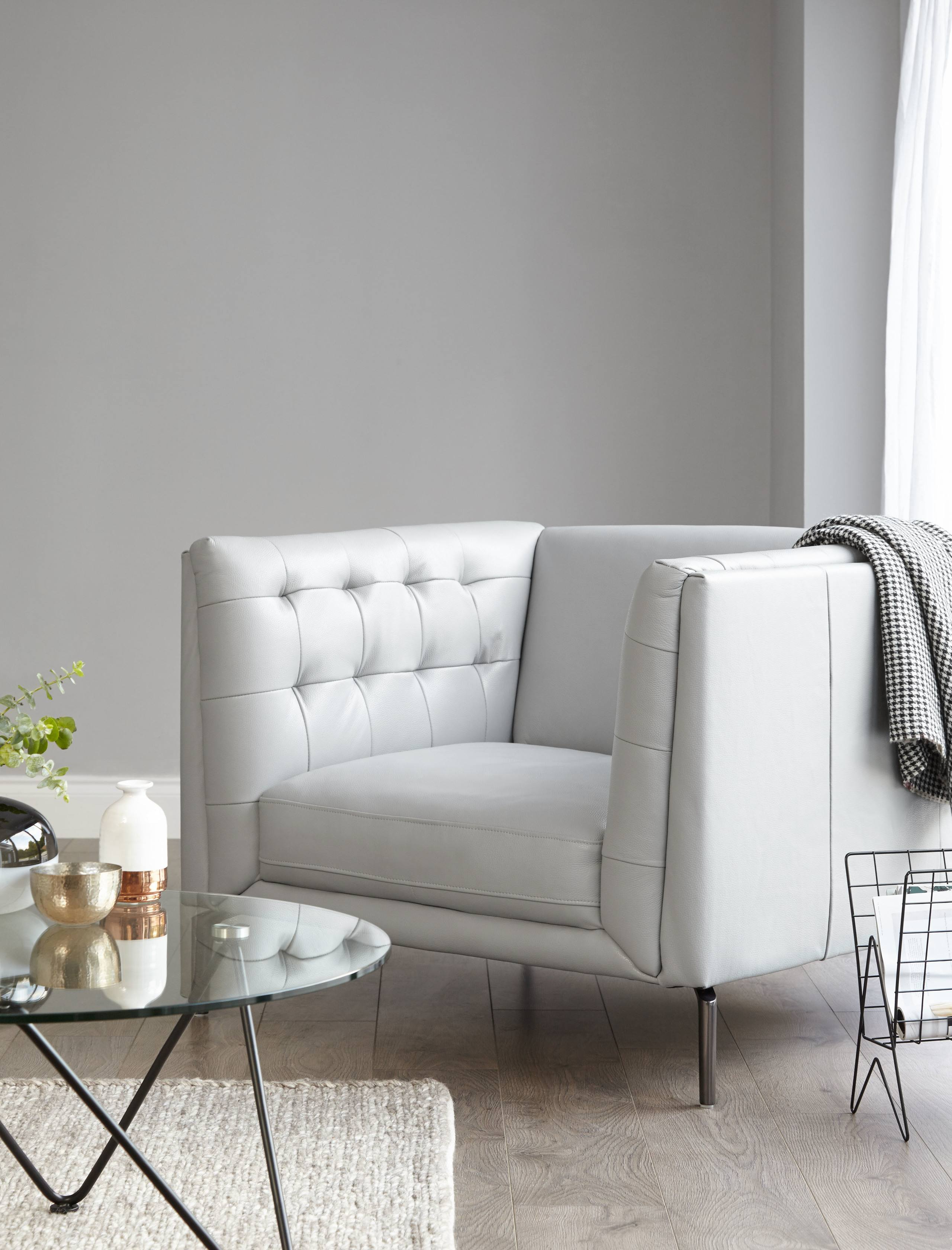 Create impact in your living room with a quilted detailing and high arms. Product: Ellis Leather Armchair