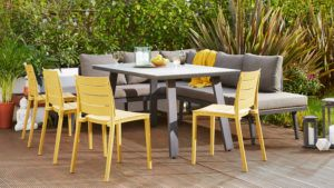 Grey Palermo Corner Bench, Yellow Edie Armchair and Grey 6 Seater Fresco Dining Table