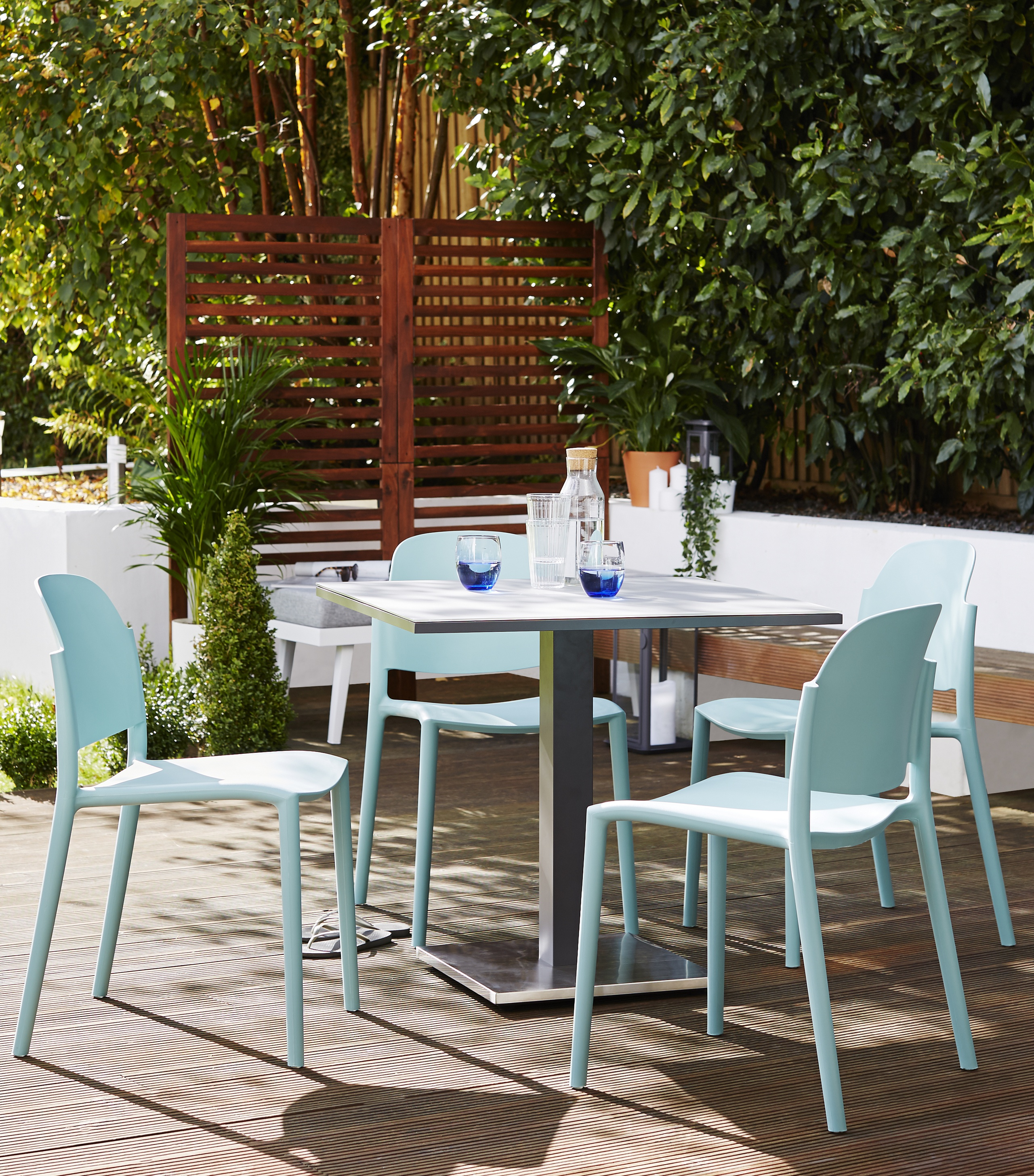 7 Outdoor Furniture Buying Mistakes You'll Want To Avoid! Image: Palermo Grey Pedestal Table and Lola Small Dining Set