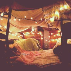 Make a den with cushions and fairly lights