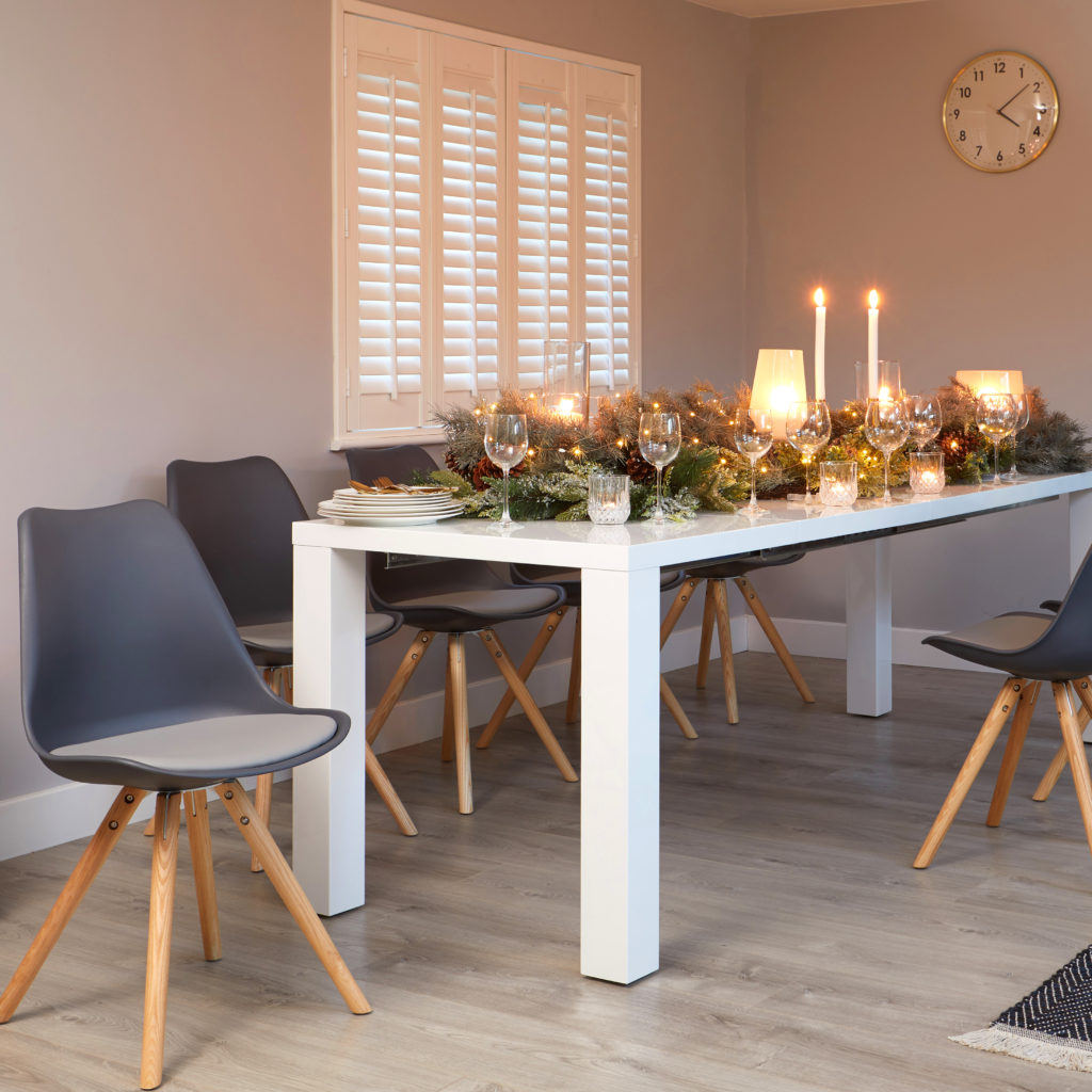 Grey gloss extending dining table that seats from 4 to eight.